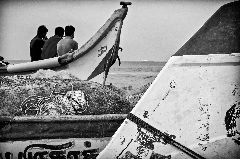 Three Men no a Boat - Marina beach, Chennai, India by Mike Weiser
