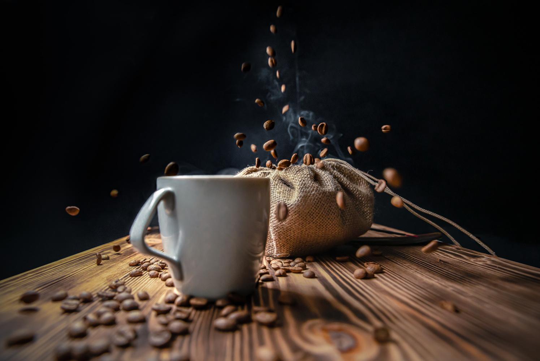 falling coffee beans by Thomas Balagula