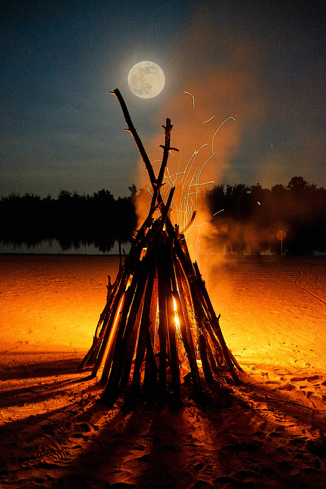 bonfire on the background of the river and the moon by Bogdan Pigulyak