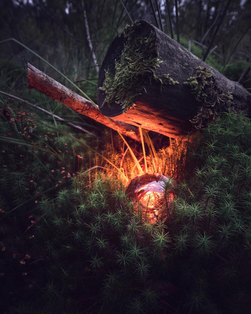 Glowing Lensball by Sebastian Kuempflein