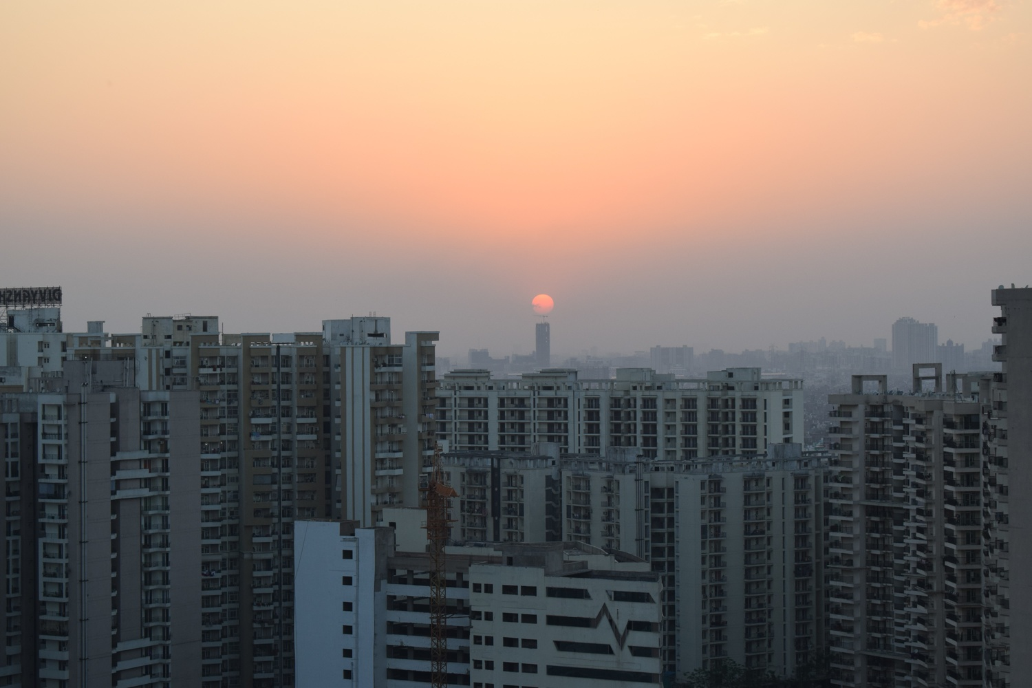Sunset Over Tall Buildings by Ritesh Dixit