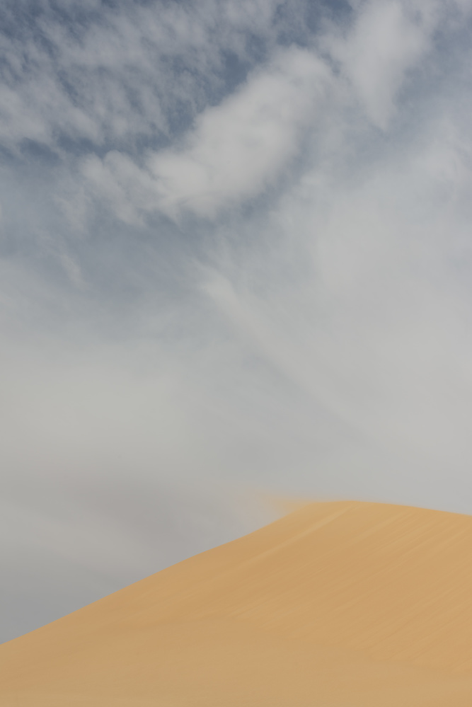 Blowing sand off a dune in Egypt by Visualize The World