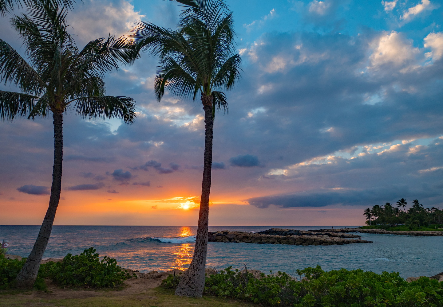 Sunset on the west side of O'ahu by Paul Chick