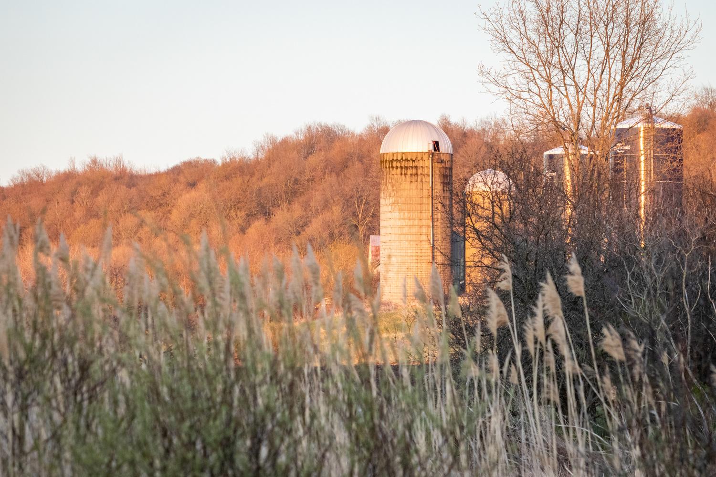 Farm Silos at Sunset by Joshua Napper