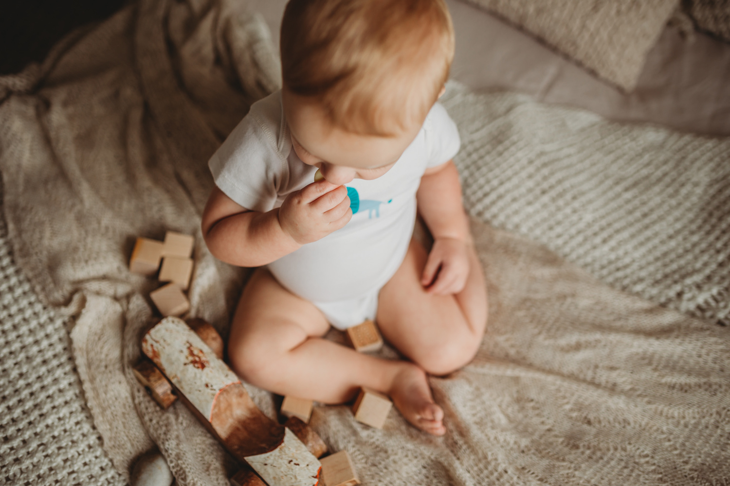 Wooden toys and baby by Michelle Coxall