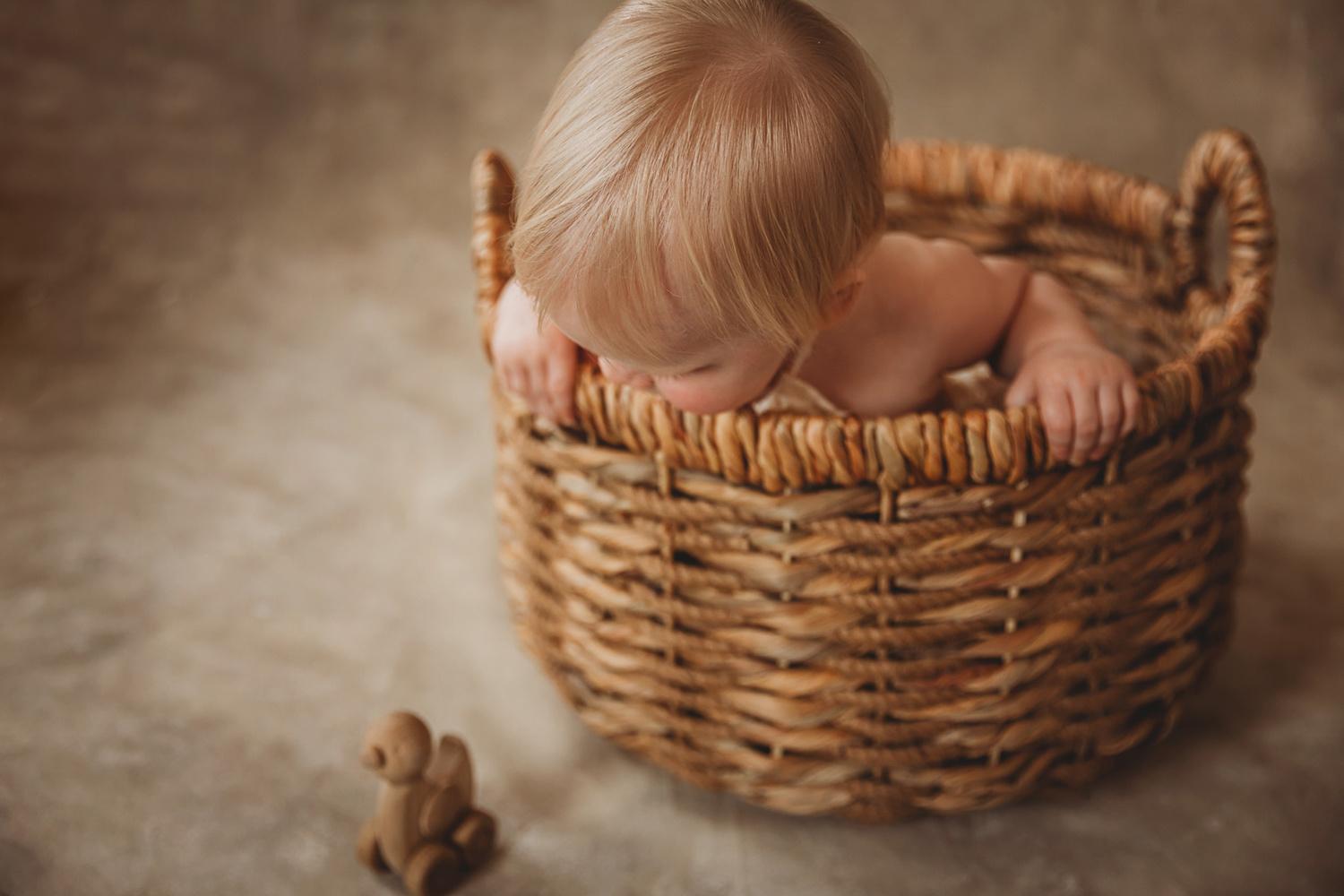 Baby girl in a basket by Michelle Coxall