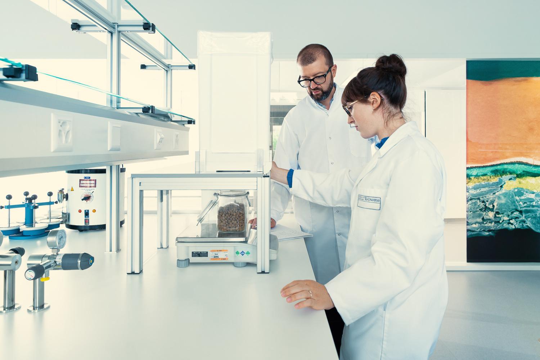 People working in a clean laboratory by Alexander Petrenko