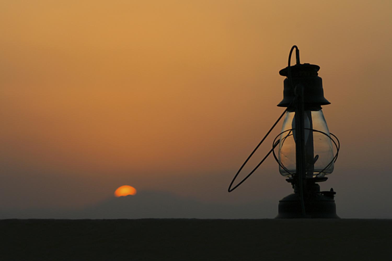 ornamental lamp at sunset by Simon Richards
