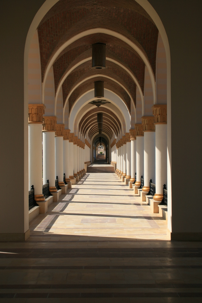 passage lined with ornamental columns in the day by Simon Richards