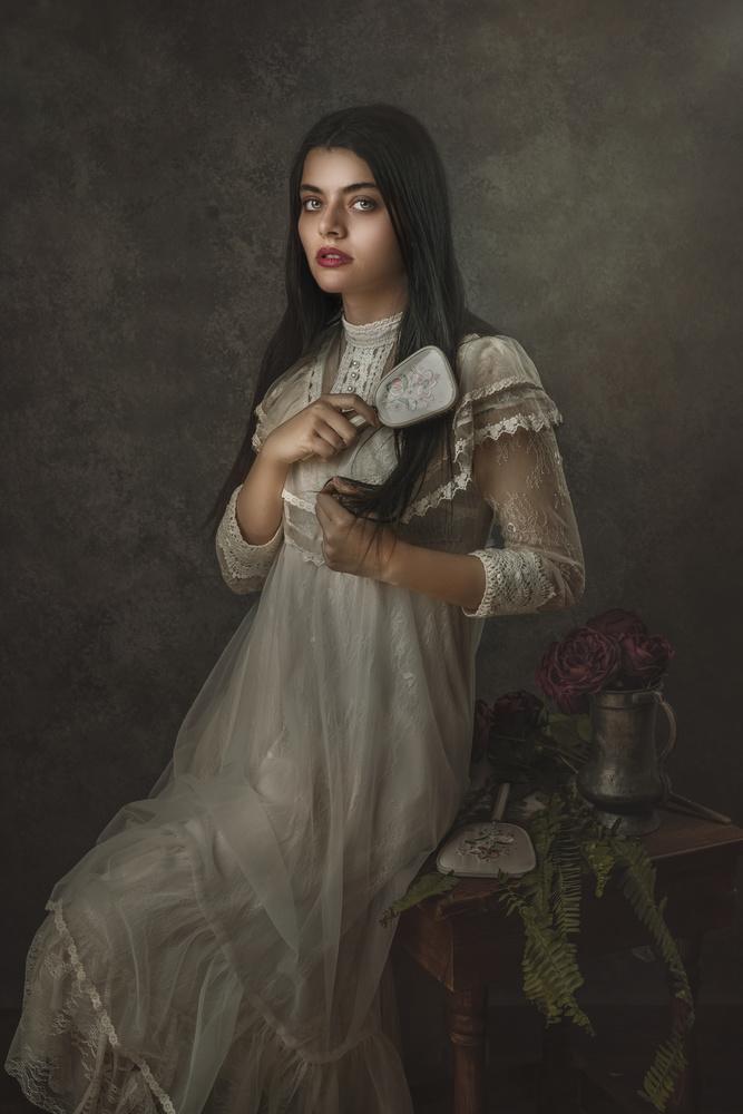 Young women Combing Her Hair by Farida Farhat