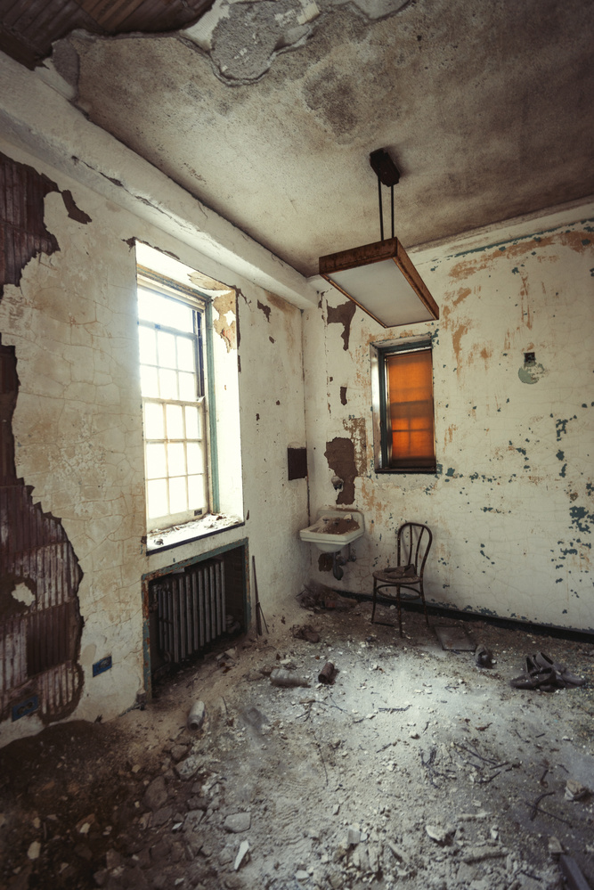Untitled (abandoned room with chair and window) by Juno Morrow