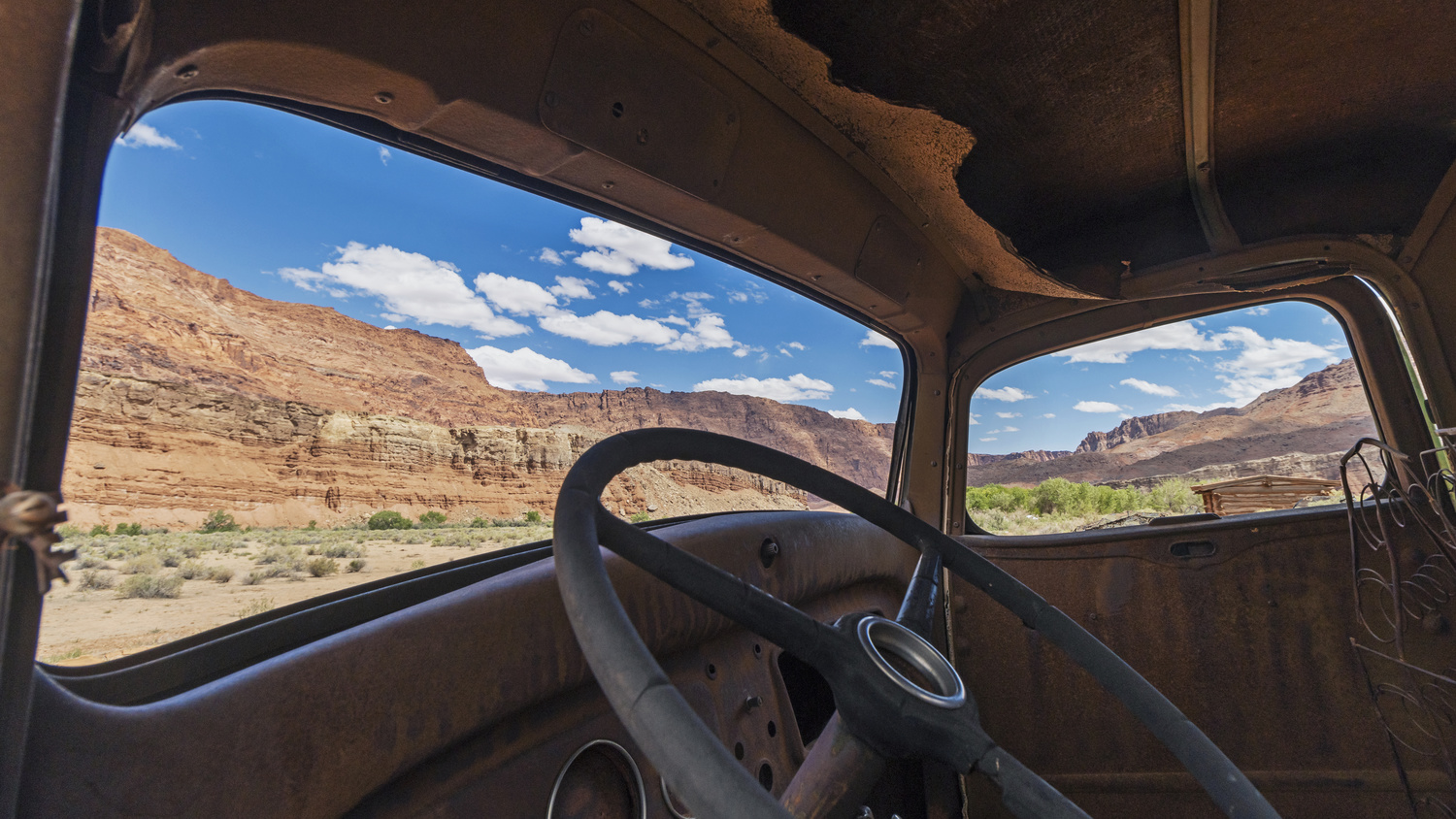 Abandoned Truck With A Red Rock View by Ray Redstone
