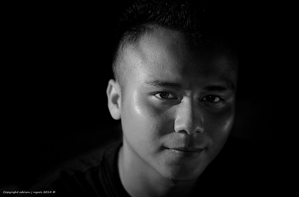 Male; singlelight (outdoor) headshot by Adrian J Nyaoi