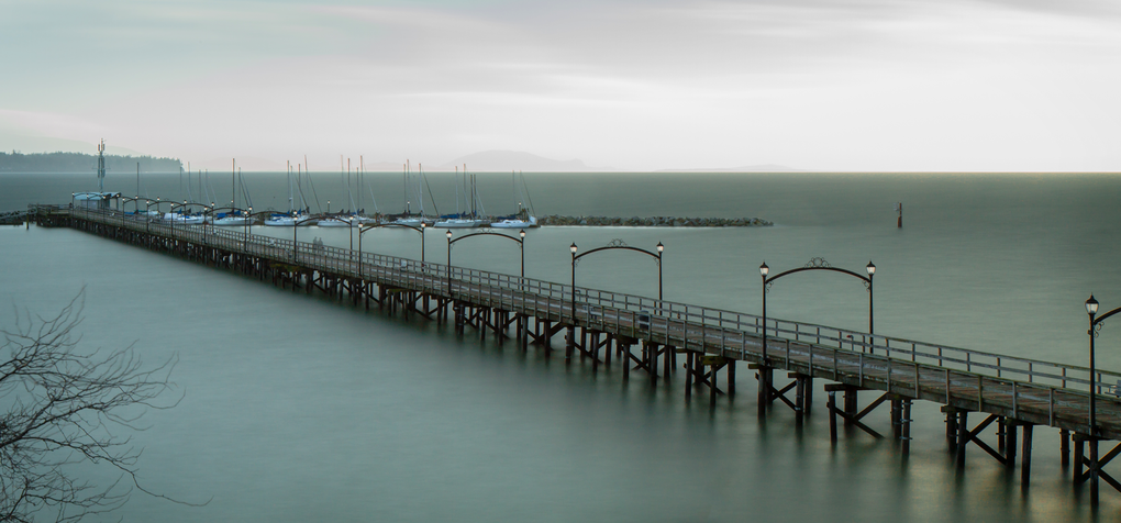Ghostly Figures On The White Rock Pier by Ben Karlstrom