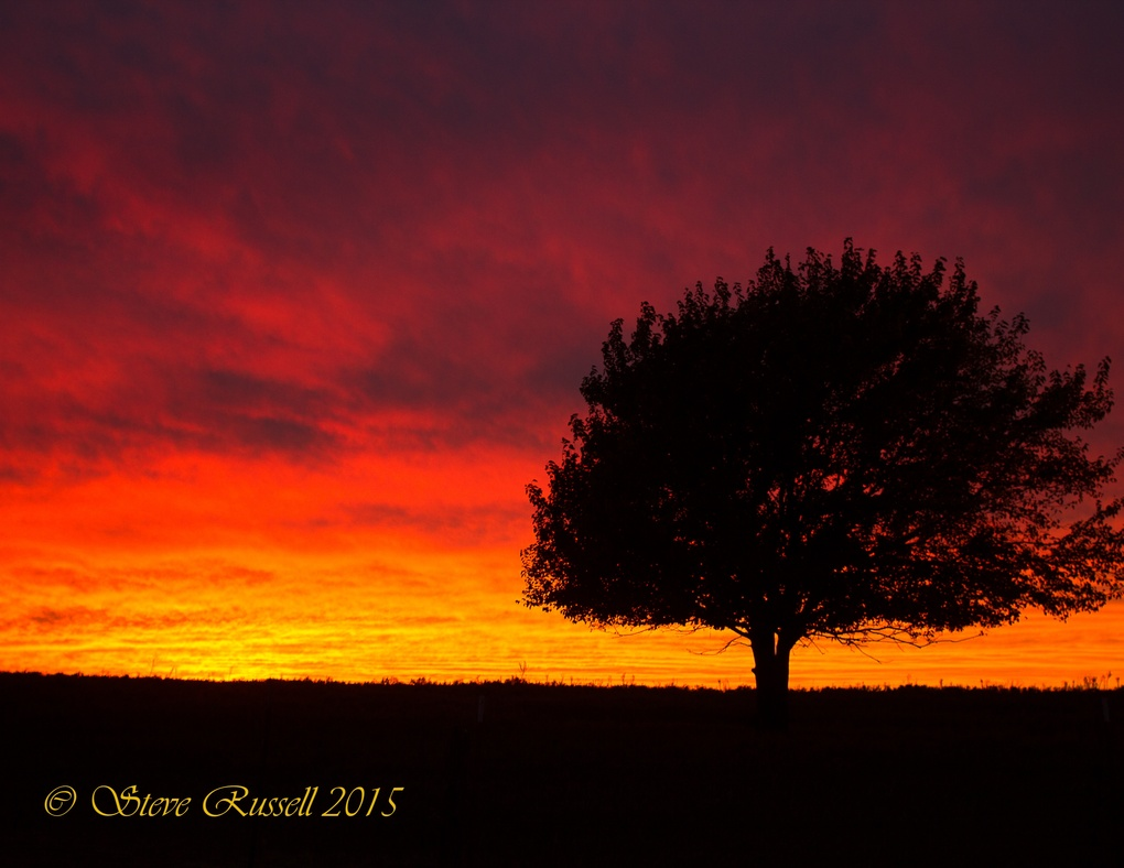 Sunset in fall by Steve Russell