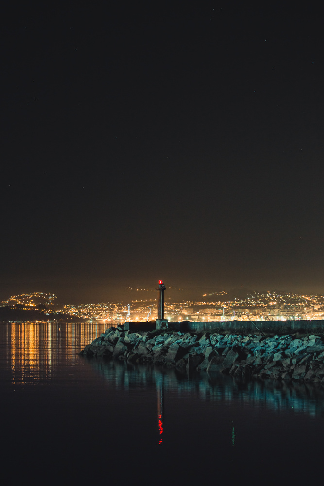 A lighthouse in the port by Ave Calvar Martinez