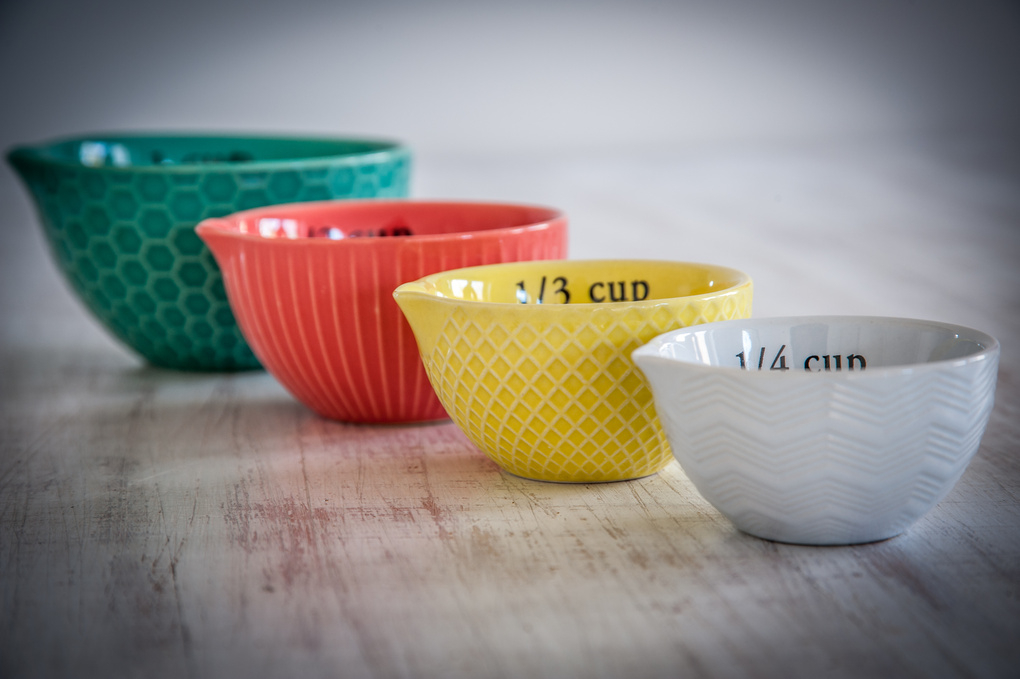 Colourful measuring cups by John John