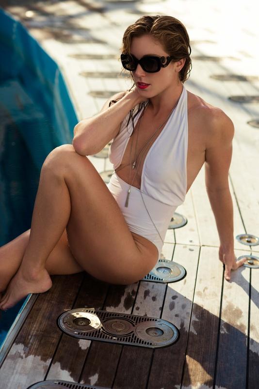 Prada at the pool by Caroline Miller