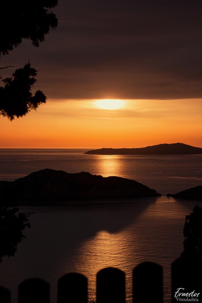 Sunset Over afionas beach corfu greece by ernestos vitouladitis