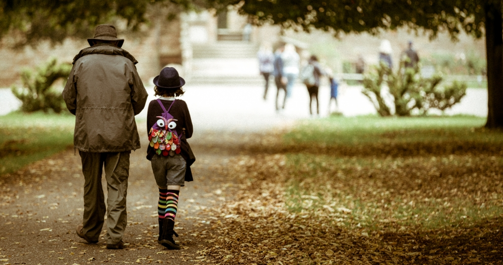 Two generations apart taking a stroll by Kevin Frost