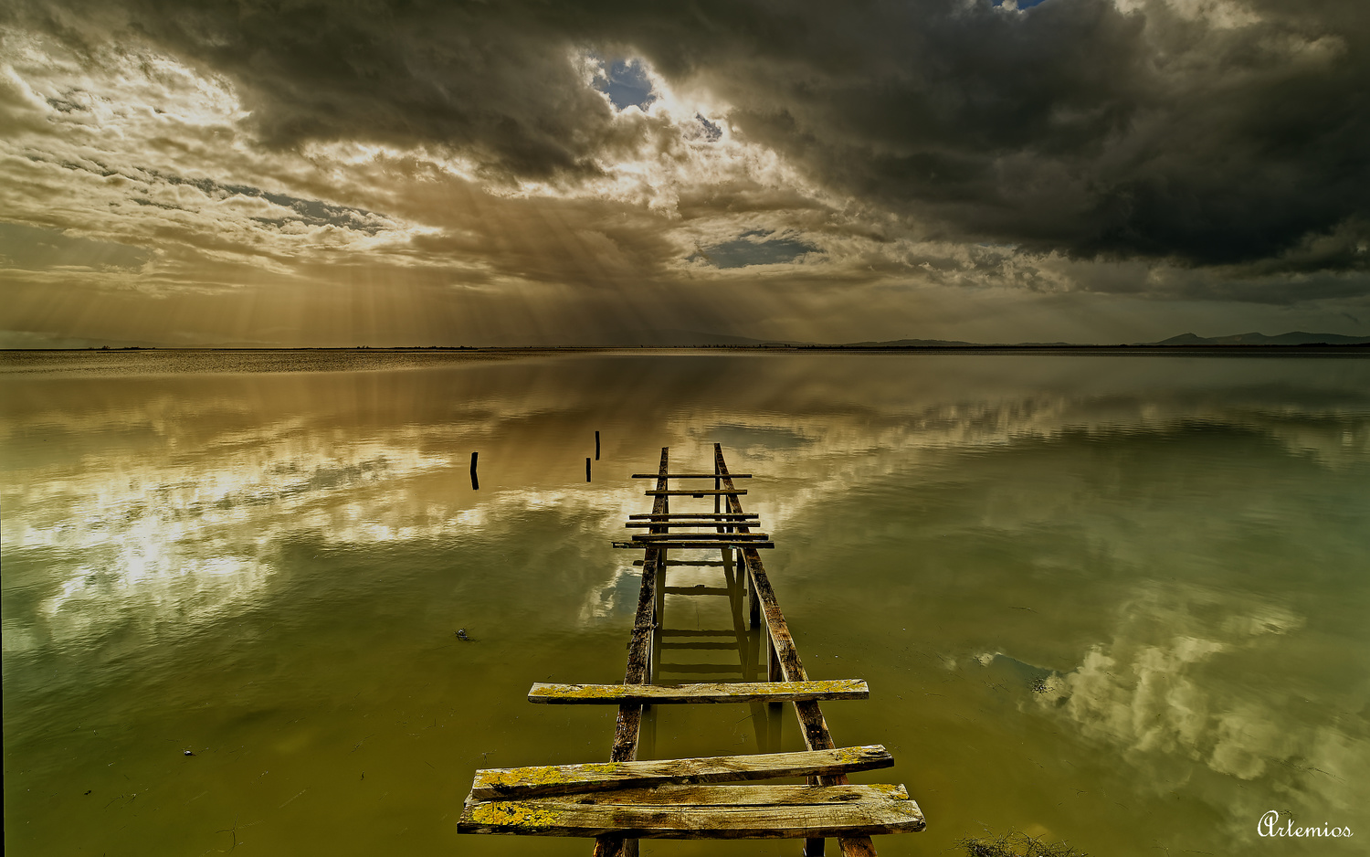 An old fishing dock at an abandoned fishing village by Artemios Chalaris