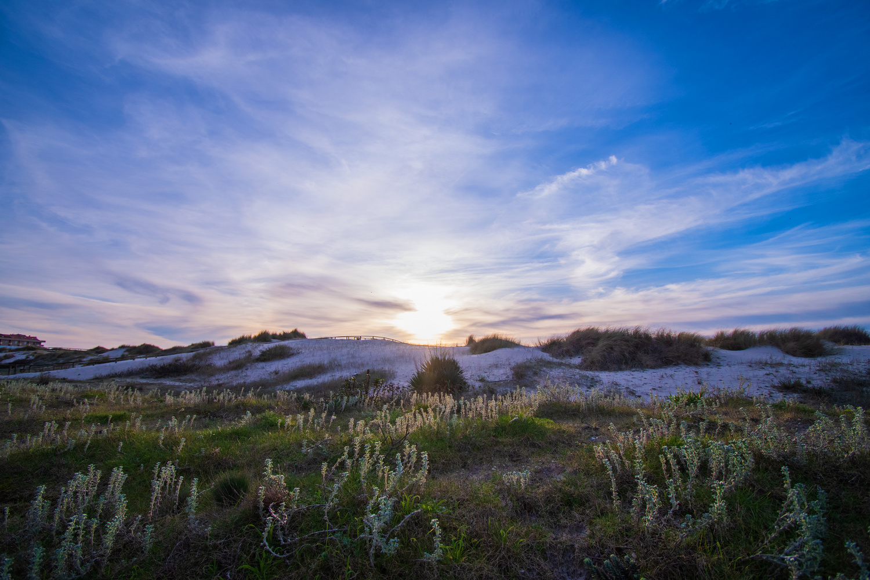 Sunset behind the dunes by Soraya van den Berg