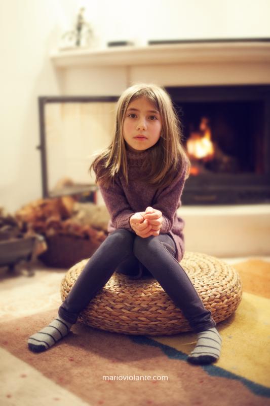 Girl at fireplace by Mário Violante