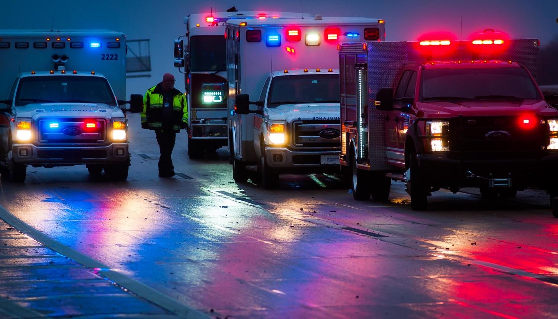 Emergency vehicles at dusk, Ada, Oklahoma by Richard Barron