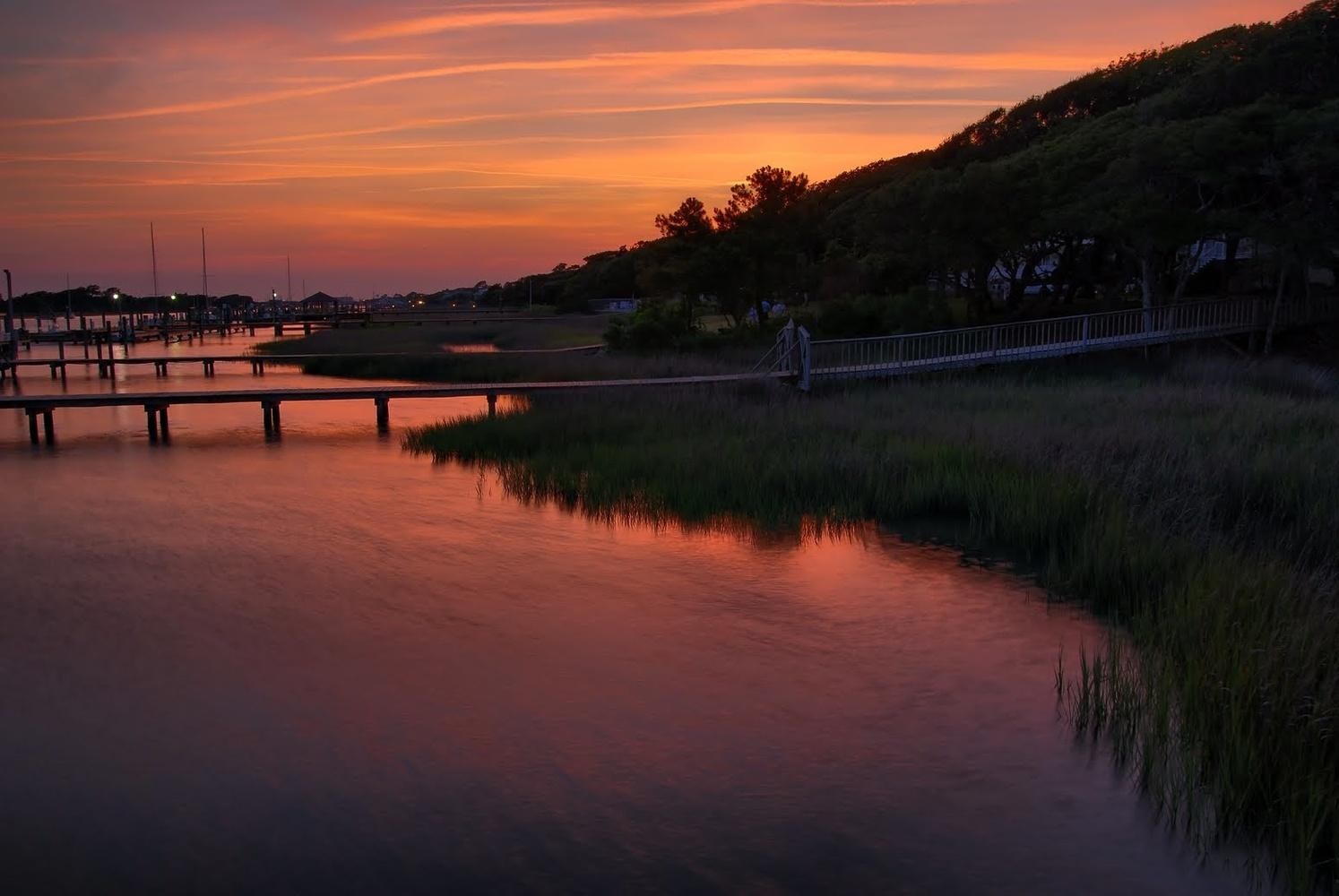 Coastal scene as the sun sets by Stanley Westfall