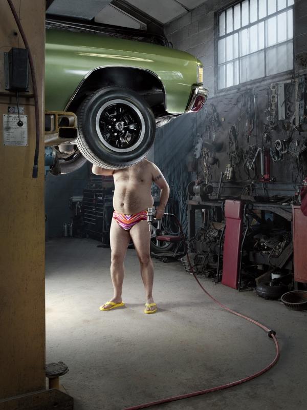 Speedo-clad Mechanics 1 by John Fulton