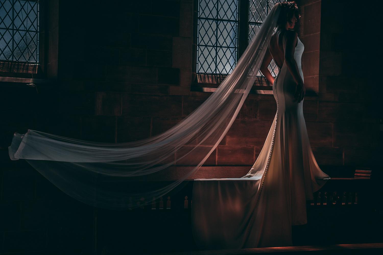 Bride in a window by Adam Galliford