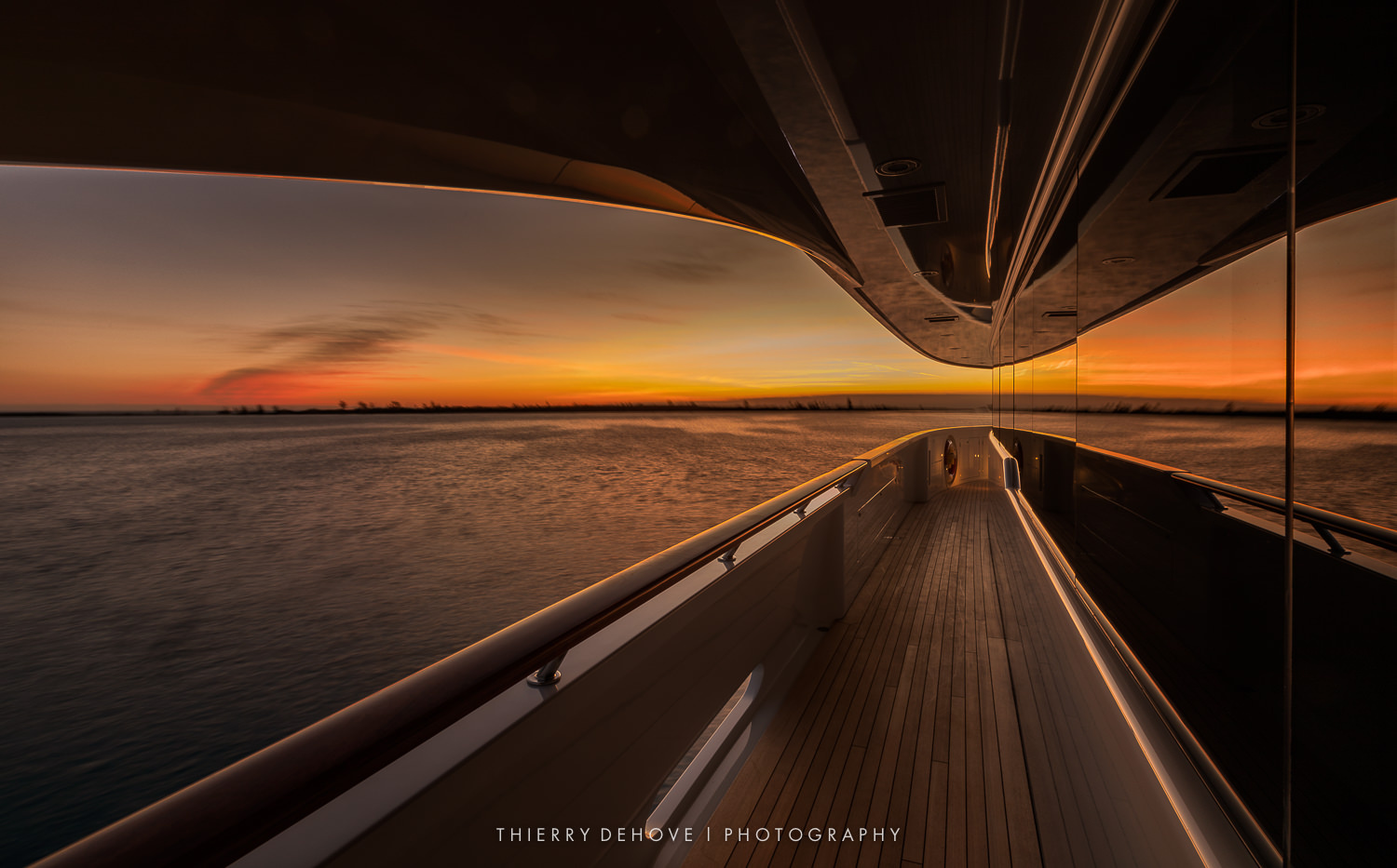 Sunset on Mega Yacht in Bahamas by Thierry Dehove
