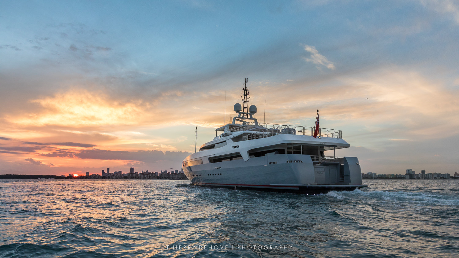 Sunset on Mega Yacht in Miami by Thierry Dehove