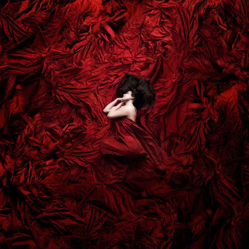 Laying in Red by Tim Skipper