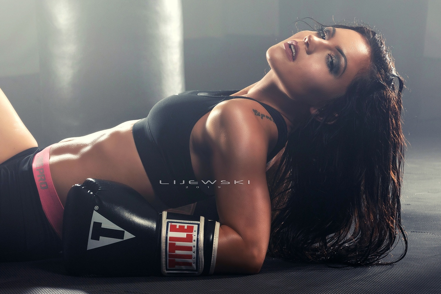 Caitlin - Resting after Workout by Paul Lijewski
