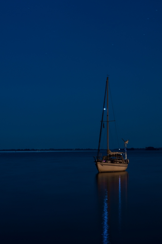 Sailboat at 10 pm - Chesapeake Bay by Walt Polley