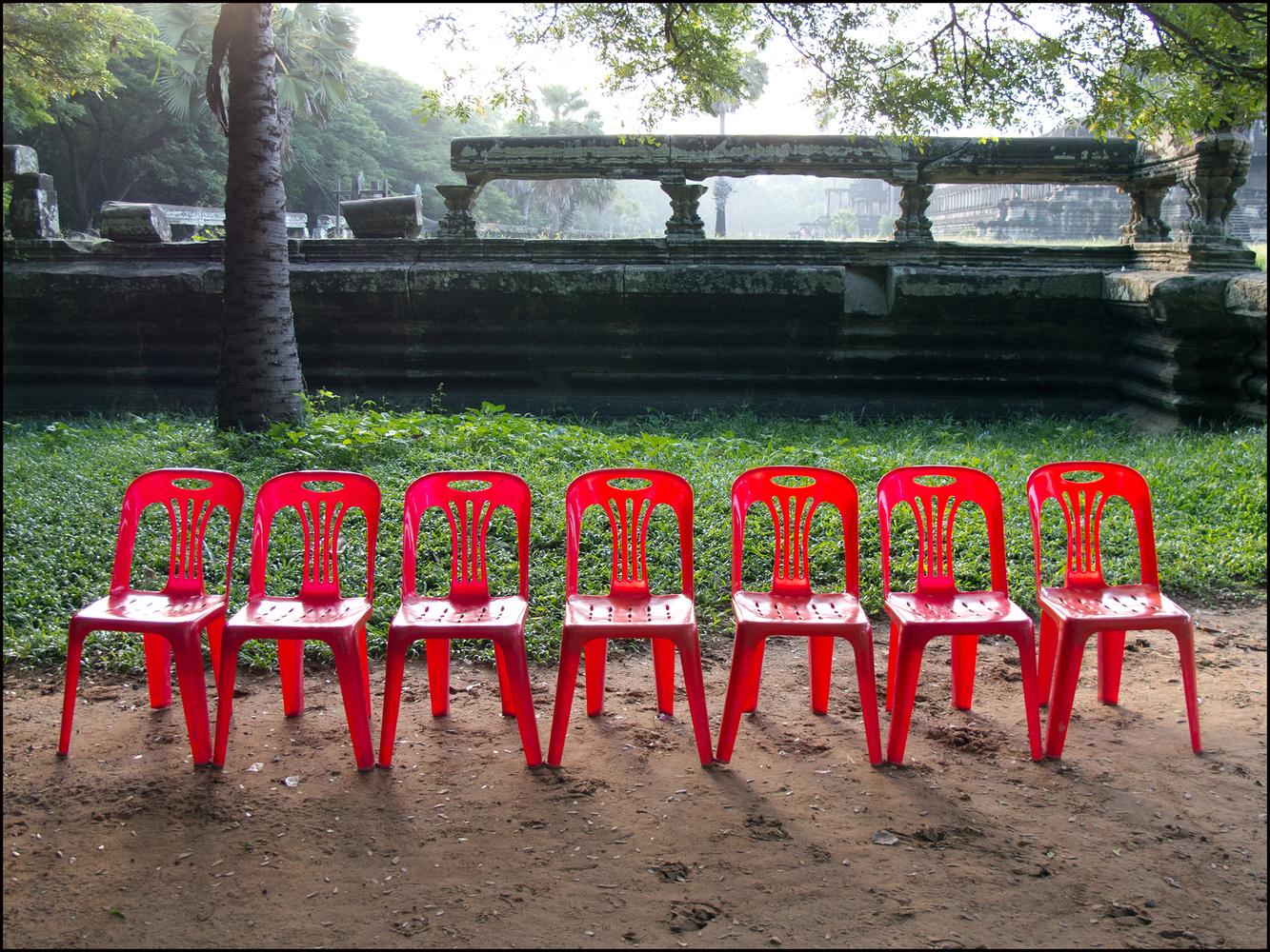 Red Chairs at Angkor Wat Temple by John Langford