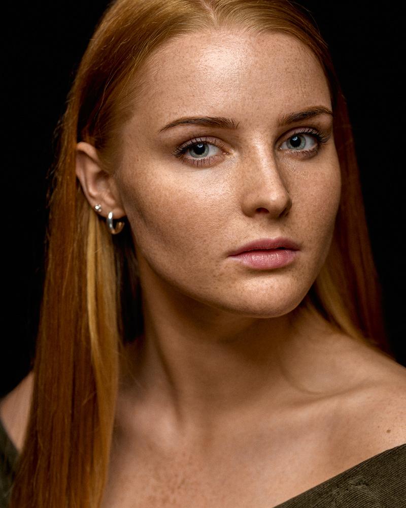 Girl with freckles by Saulius Kerikas