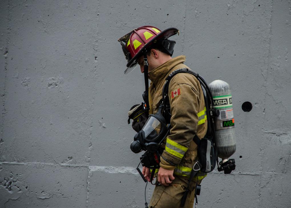 Exhausted firefighter by Robert Watt