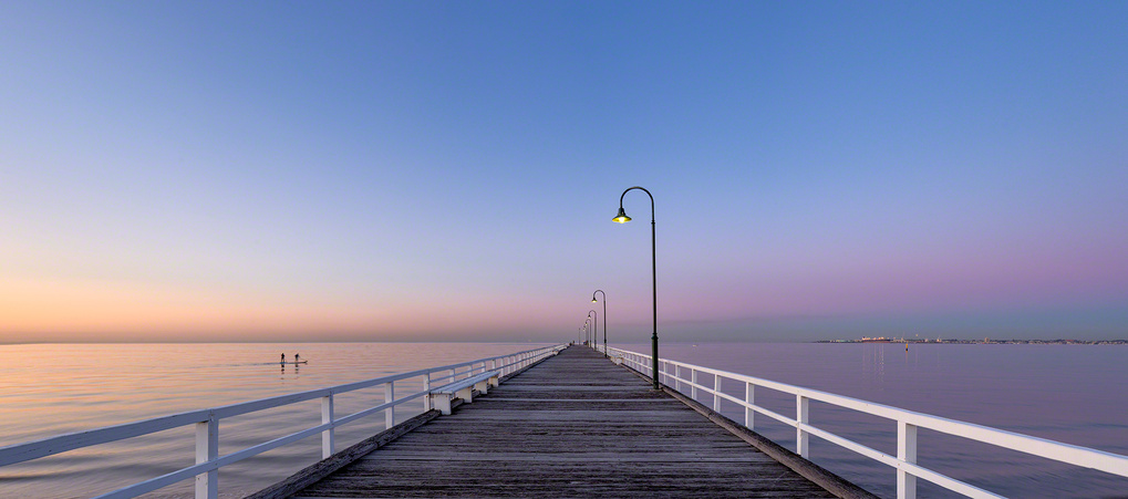 Dawn at the pier by Allan Savage