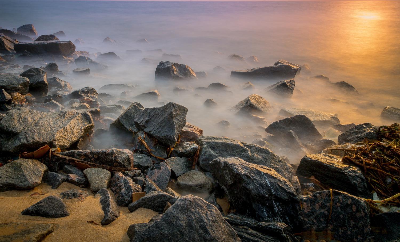 Rocks On The Beach by Bernard Okulaja