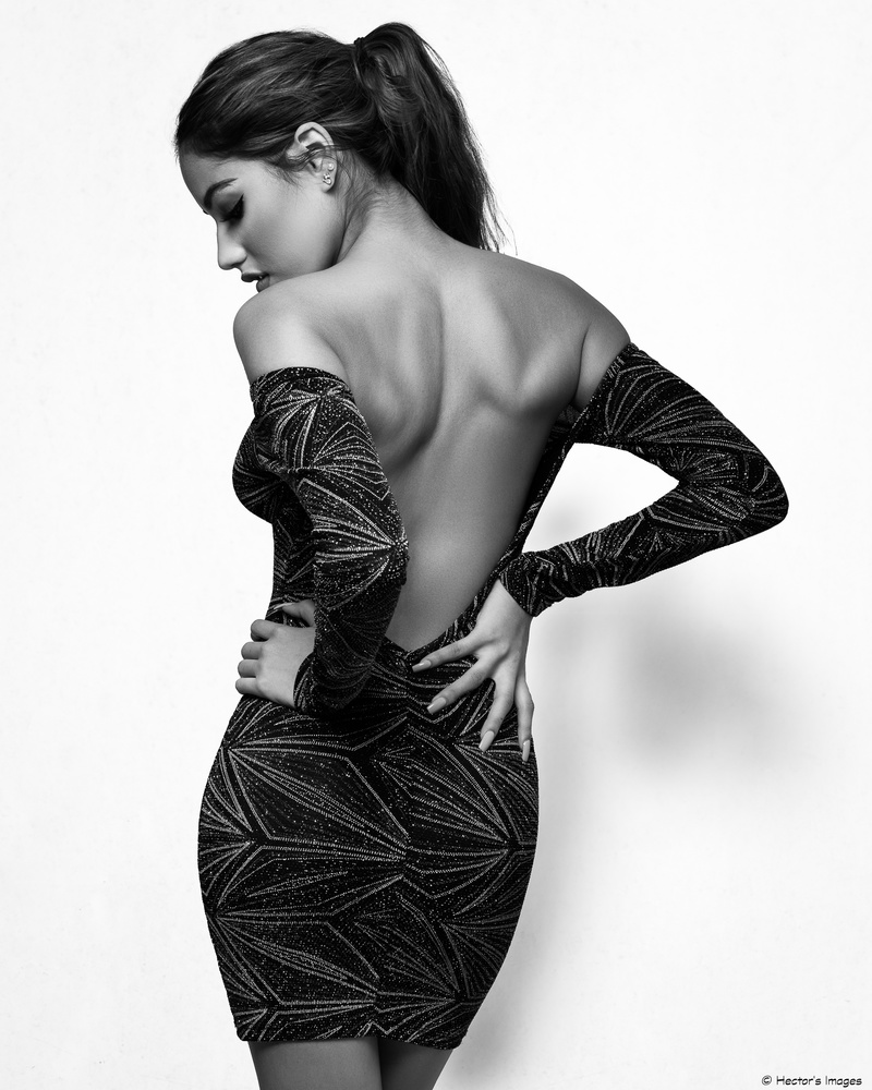 Sofia's backless dress by Hector Reyes