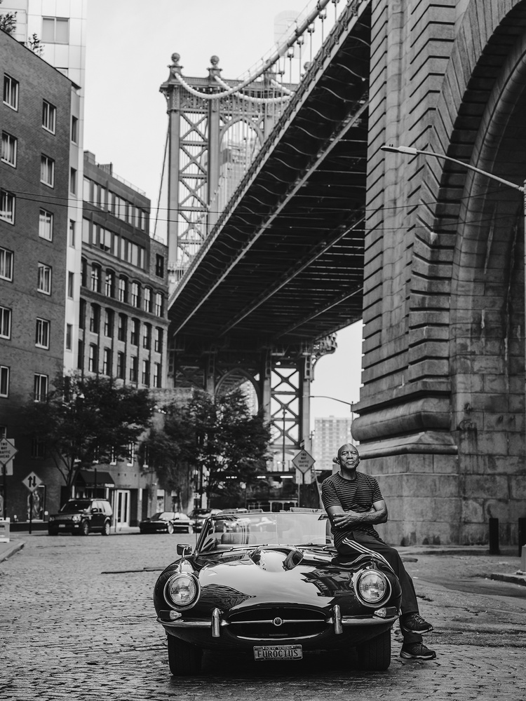 George and his E-Type under the Manhattan Bridge by Shaun Maluga