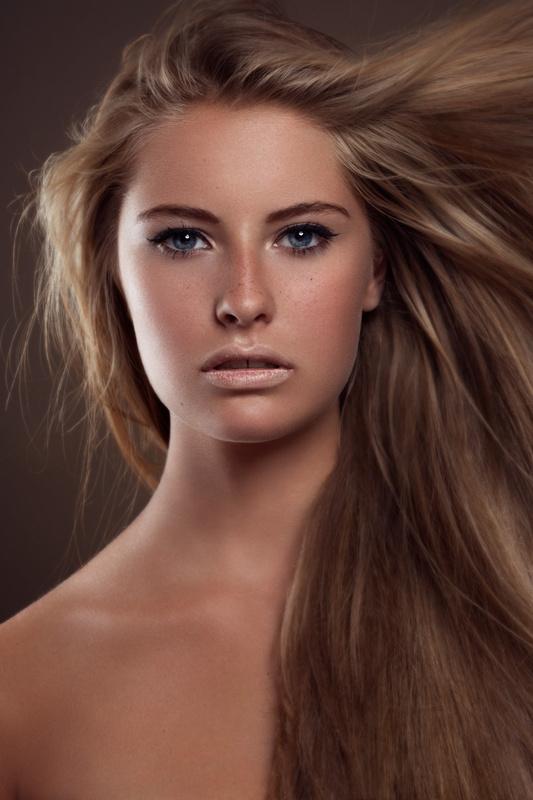 Blowing Brunette hair by Christian Bela