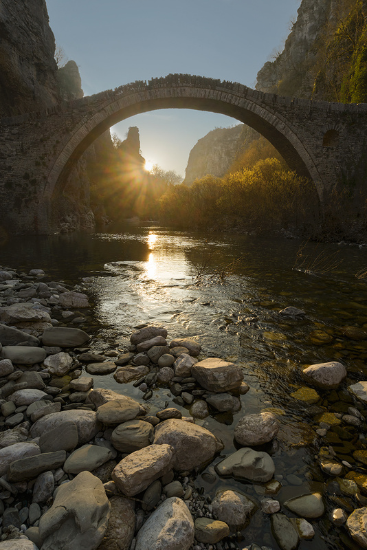 A (sun) Star under the old Bridge by Bill Peppas