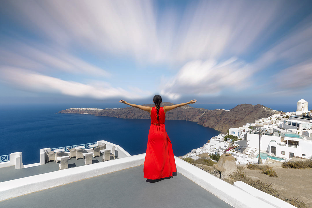 Taking in the Santorini View by Bill Peppas