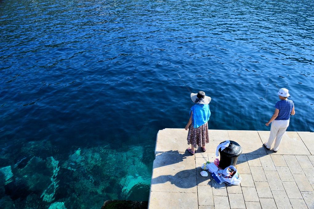 Ladies Fishing  by Mario Stegic