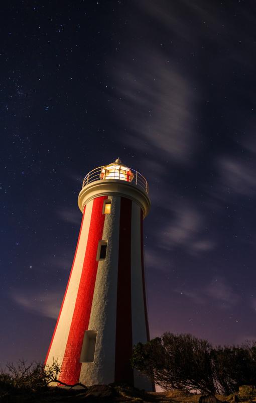 Lighthouse in the dark by lorenzo pecher