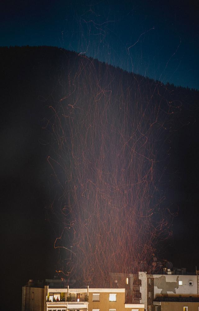 bonfire sparkles up in the sky by Nace Zavrl