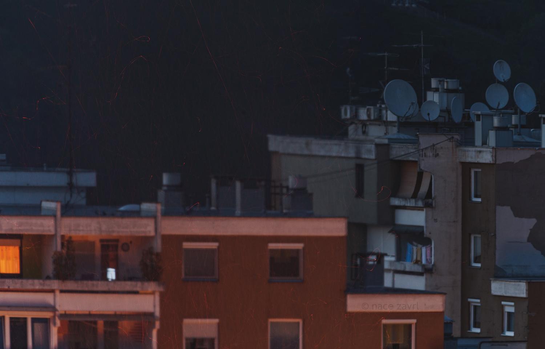 bonfire sparkles over the building by Nace Zavrl